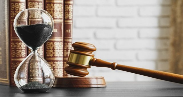 Court,Concept.,Hourglass,And,Judge,Gavel,On,Table,Close,Up